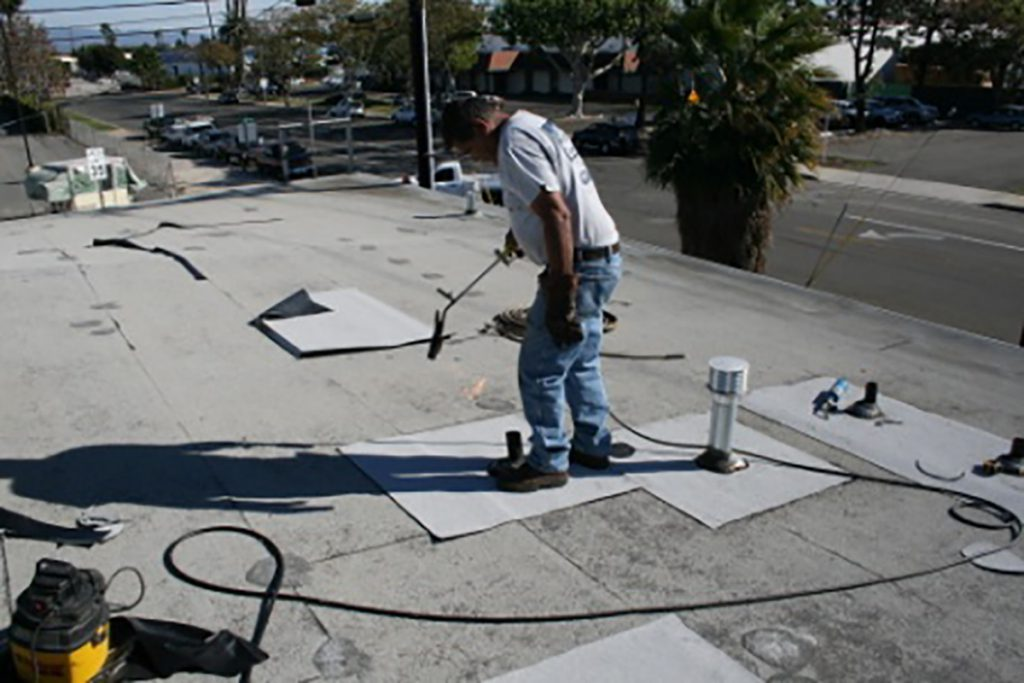 Flat roof heat application in California